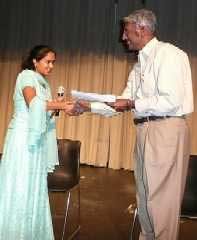 Selvi Kaviya receiving award from Mr.Ram Mohan
